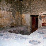 Pompeii bar. Themopolium of the Lararium.